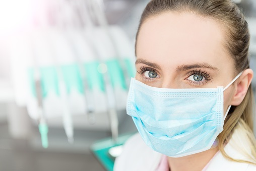 Dentist wearing a disposable facial mask