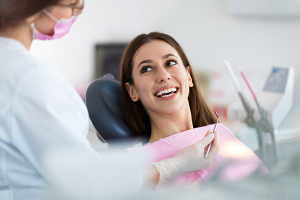 Woman smiling in a dental chair